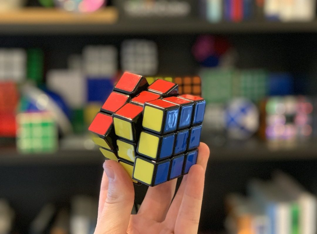 Holding up Rubik's brand 3x3 cube.