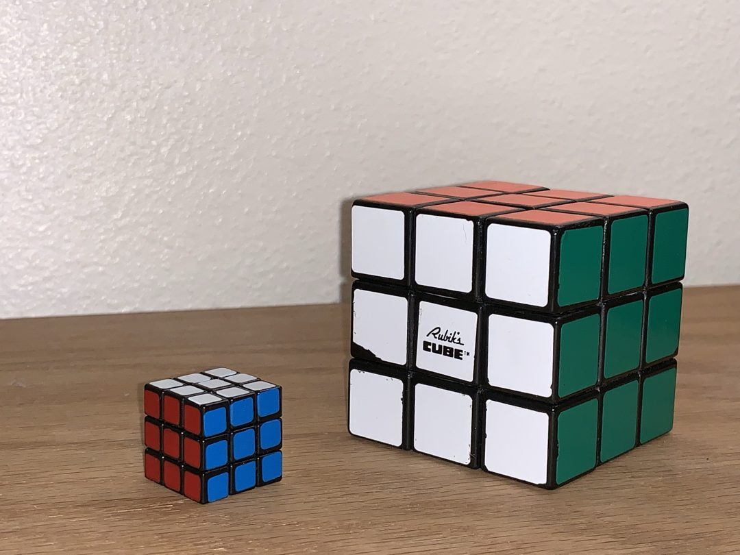 World's Smallest Rubik's cube next to standard sized cube.