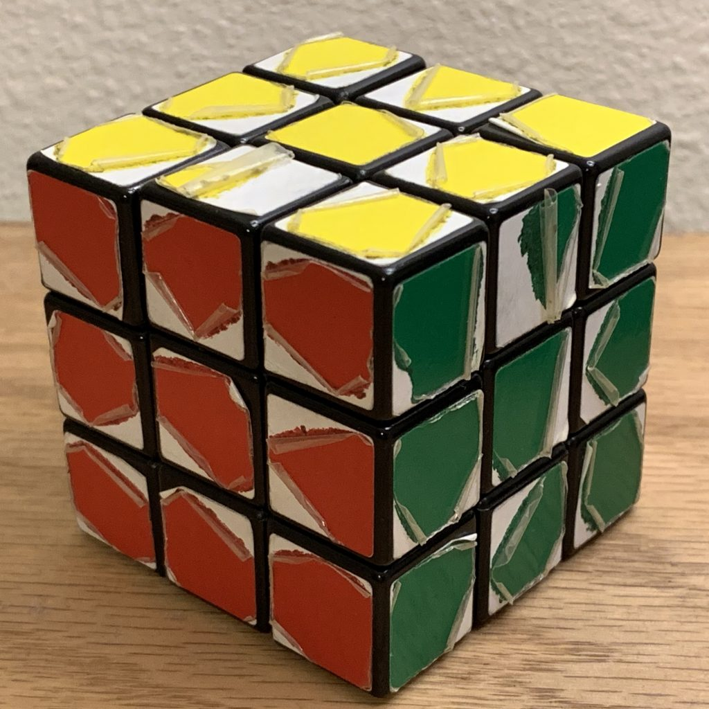 Rubik's cube with stickers peeling off